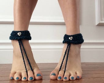 Crocheted teal barefoot sandals with silver heart buttons