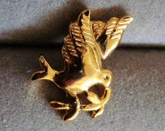 DOVE PIN is 3/4 Inch tall by 1/2 inch wide  condition like new, punch pin back. See description area please .