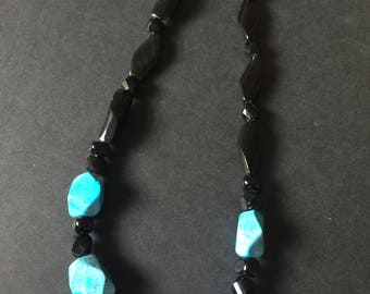 A single strand Black and Turquoise beaded necklace