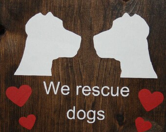We rescue dogs. Dog rescue sign. Adopt a dog.