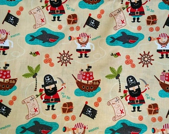 100% cotton, fabric pirates on a beige background