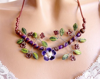 Purple spring green leaves and ceramic Flower necklace.