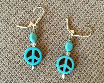 Turquoise howlite peace sign earrings with turquoise accents