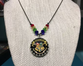 Beaded accent Hogwarts crest necklace - crown edge