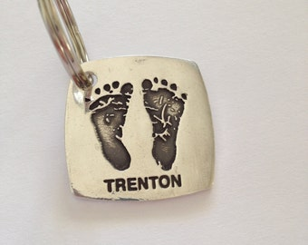 Silver Footprints or Handprints with a name on front Made from your child's actual prints into a Silver Keychain