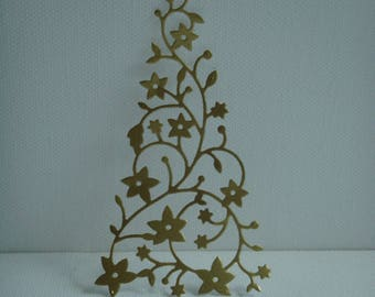 Cutout tree snow paper covered with vinyl design gold to create