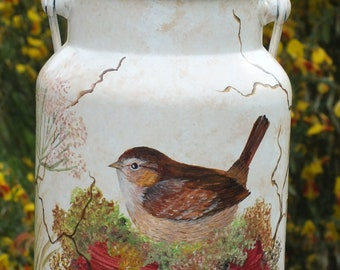 Vintage: paint on an old milk can - a sweet little bird in flowers...
