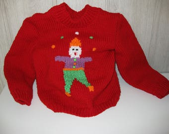 Red Sweater with clown juggler in diagram