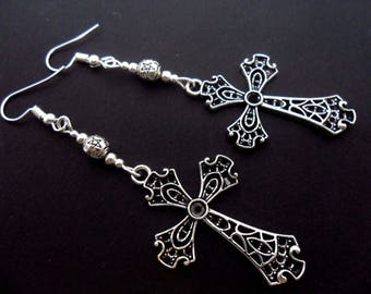 A pair of long tibetan silver cross dangly earrings.