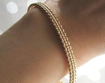 Bangle semi-open pattern woven plate embossed gold 750/1000