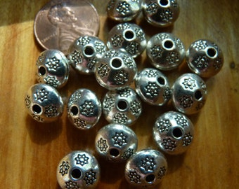 Pewter rondell beads with flower stamping