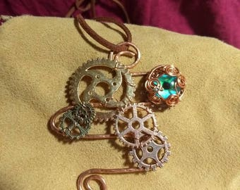 Steampunk pendant with green dragon eye in recycled copper wire
