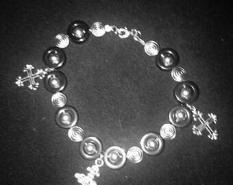 Hemalyke cross bracelet