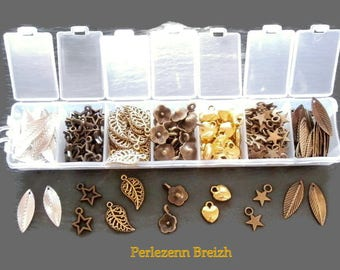 Box assortment of 300 various silver, bronze and gold metal charms