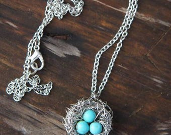 Bird's Nest Necklace - Silver wire-wrapped with turquoise beads and feather charm