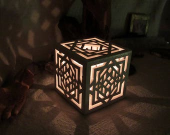 Cubic ceramic candle holder / shadow lamp with symmetric light patterns