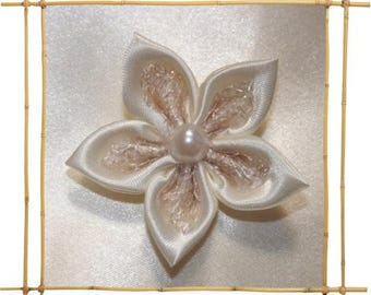 satin and ivory mesh flower