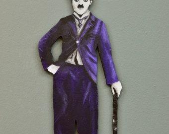 Purple painted Charlie Chaplin figure