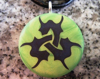 Tribal Trinity Symbol hand carved on a polymer clay green pearl color background. Pendant comes with a FREE Necklace