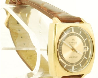 """Baylor automatic """"Norseman"""" with date vintage wrist watch, 17 Jewels, yellow gold plated & stainless steel water resistant case"""