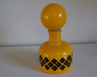 Vintage 70 yellow, black and red bottle