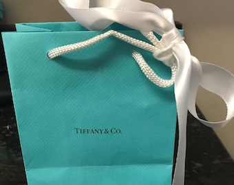 5b98b39453 TIFFANY & CO. Brand New Blue Bags with Tiffany Insignia and a White Ribbon  to