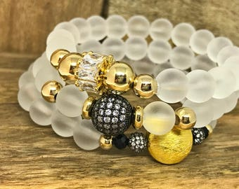 Glass White Beaded Bracelets Set with gold field beads and some bling.