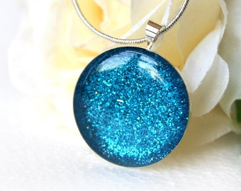 Blue glittering girl pendant, blue glittering round necklace, jewellry resin blue round pendant