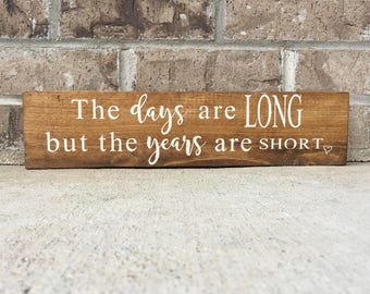 The days are long but the years are short. - Wooden Sign