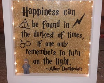 Harry Potter Quote 'Happiness can be found in the darkest of times, if one only remembers to turn on the light' Box Frame