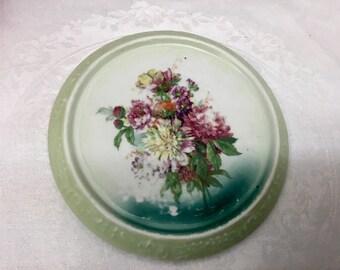 Antique teapot trivet