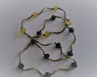 Three black and gold bracelets