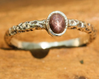 Multi brown star sapphire ring in silver bezel setting with sterling silver hard texture oxidized band