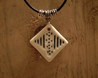 Hand-made necklace by me - Porcelain diamond shaped, black on white pendant on leather cord - magnetic clasp.