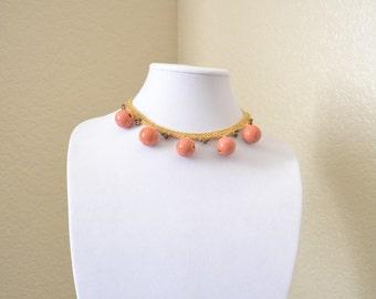 Beige and orange crochet statement necklace