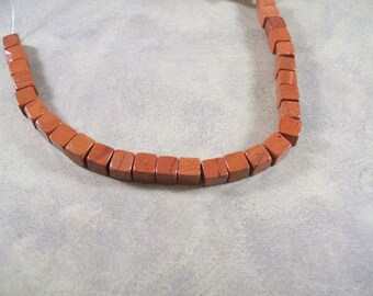 7mm Red Jasper cube beads - 7 inch strand