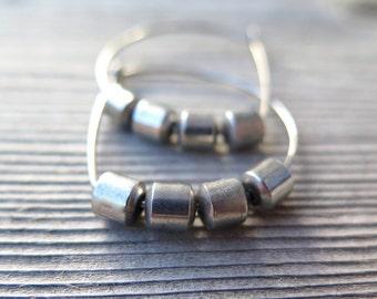 silver hoop earrings. hypoallergenic niobium wire hoops. modern hematite jewelry. silver earings.