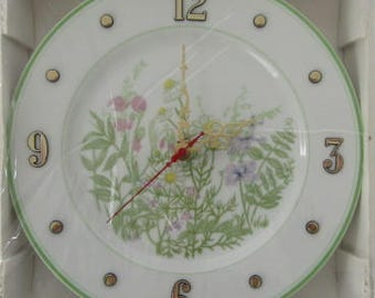 Garden Flowers Decorate a Plate That Was Hand Crafted Into a Battery Operated Clock Spring Colors With Green Edge