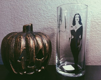 Vampira glass vase candle holder.