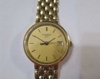 TISSOT swiss made all original SOLID GOLD 14k. watch with 14k. solid gold bracelet