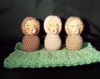 Three Sleeping Babies - Shades of pinkand Mauve-Green Blanket