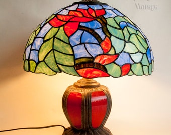 Vintage 1980s/90s Cast Iron Table Lamp Light with Red and Blue Tiffany Style Shade in Full Working Order and PAT tested.