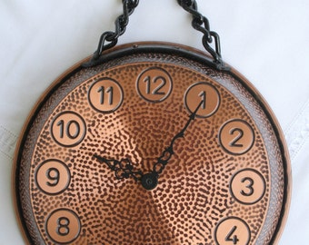 Embossed copper clock to hang on the wall.
