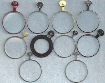 10 trial or optical lenses.. . some very different.. make your own jewelry