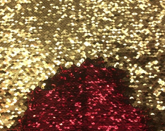 Mermaid flip up sequin shiny red on one side with shiny gold at the other side when it flips  on stretch fabric sold by the yard
