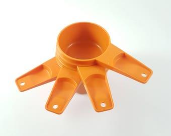 4 Tupperware measuring cups - Orange
