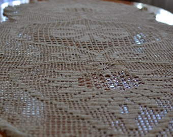 Gentle crochet-knitted tablecloth