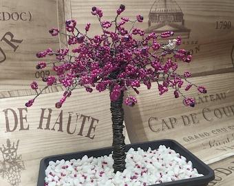 Beautiful purple seed bead tree with Iris Aurora Borealis swarovski crystals on every branch tip.                             PUR01