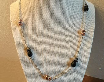 Silver chain with black and copper
