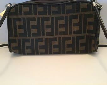 Cross body or clutch purse, Shoulder strap and zipper enclosure